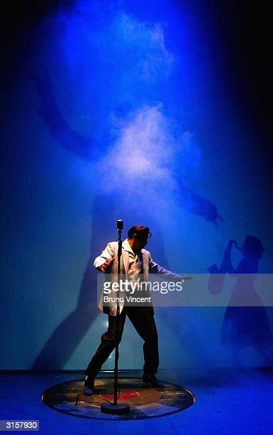 Mario Combou performs at a photocall for 'Jailhouse Rock The Musical' an Elvis inspired musical at the Piccadilly Theatre on March 30 2004 in London...