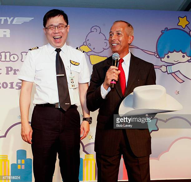 Mario Diaz Director of Aviation Houston Airports left presents EVA Chairman KW Chang with a Stetson cowboy hat during the EVA Air Hello Kitty Shining...