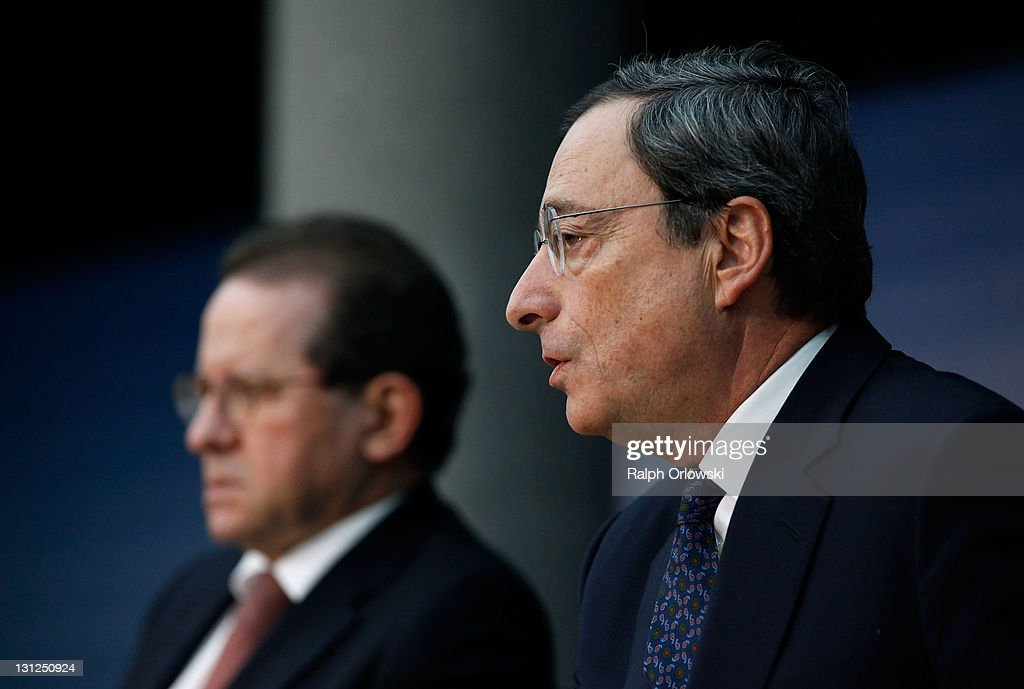 <a gi-track='captionPersonalityLinkClicked' href=/galleries/search?phrase=Mario+Draghi&family=editorial&specificpeople=571678 ng-click='$event.stopPropagation()'>Mario Draghi</a> (R), new President of the European Central Bank (ECB), sitting next to vice-president <a gi-track='captionPersonalityLinkClicked' href=/galleries/search?phrase=Vitor+Constancio&family=editorial&specificpeople=3163427 ng-click='$event.stopPropagation()'>Vitor Constancio</a> speaks to the media following the first meeting of the ECB Governing Council with Draghi at the helm on November 3, 2011 in Frankfurt am Main, Germany. Draghi officially took over from Jean-Claude Trichet as ECB President on November 1 and announced an interest rate cut of 0.25 points from 1.5 percent to 1.25 percent.