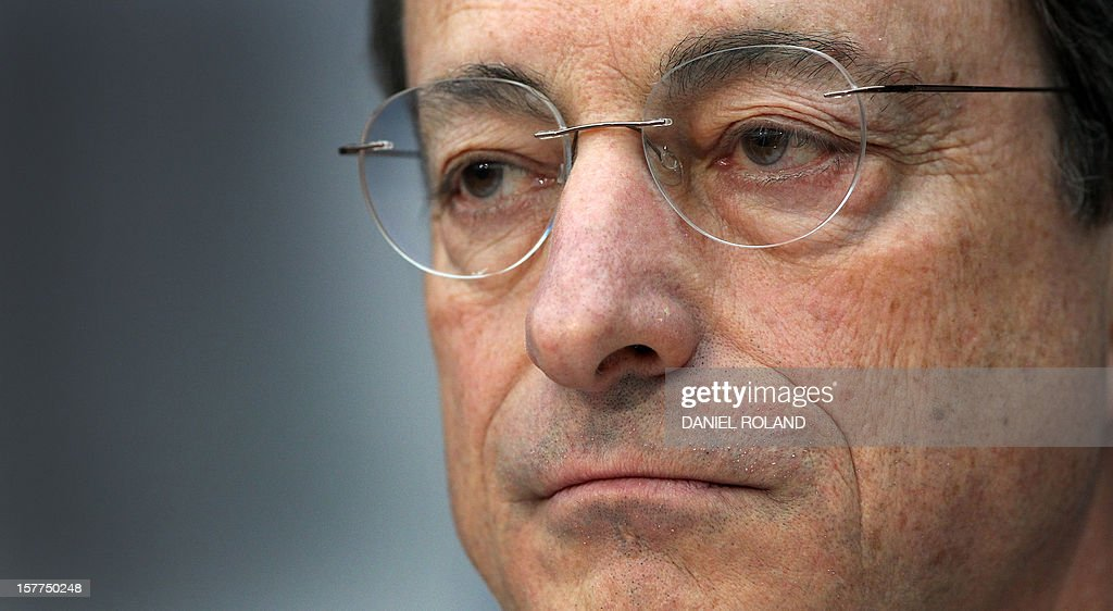 Mario Draghi, President of the European Central Bank, (ECB) addresses the media during a press conference following the meeting of the Governing Council in Frankfurt/Main, on December 6, 2012. The European Central Bank's decision Thursday to leave its interest rates unchanged at their current historic lows of 0.75 percent was not carried unanimously, ECB chief Mario Draghi revealed. AFP PHOTO / DANIEL ROLAND