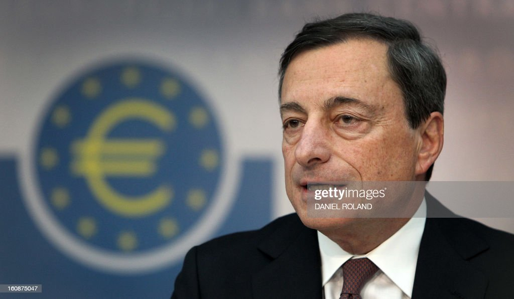 Mario Draghi, President of the European Central Bank (ECB), addresses the media during a press conference following the meeting of the Governing Council in Frankfurt am Main, western Germany, on February 7, 2013. The ECB held its key interest rates unchanged at its policy meeting despite French concerns that the euro's recent strong rise could pose a threat to economic recovery. AFP PHOTO / DANIEL ROLAND