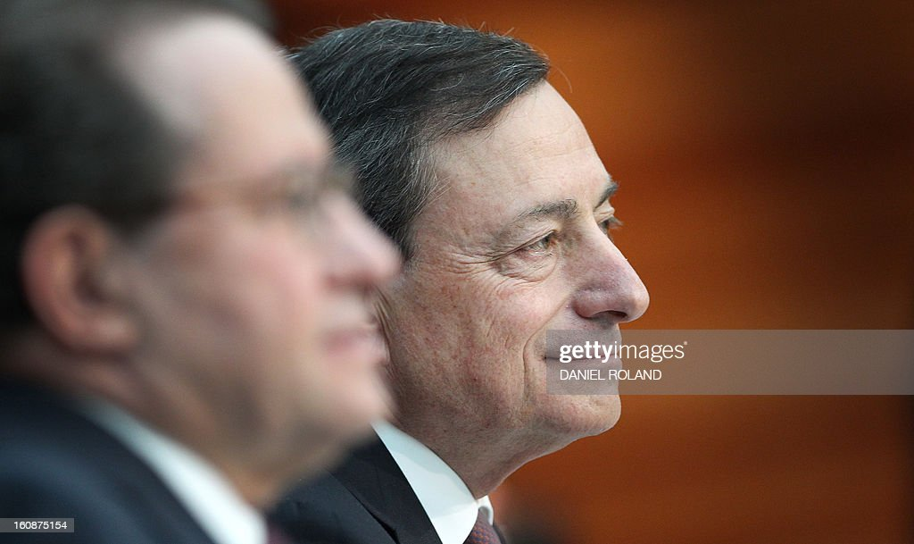 Mario Draghi (R), President of the European Central Bank (ECB), addresses the media during a press conference following the meeting of the Governing Council in Frankfurt am Main, western Germany, on February 7, 2013. The ECB held its key interest rates unchanged at its policy meeting despite French concerns that the euro's recent strong rise could pose a threat to economic recovery. AFP PHOTO / DANIEL ROLAND