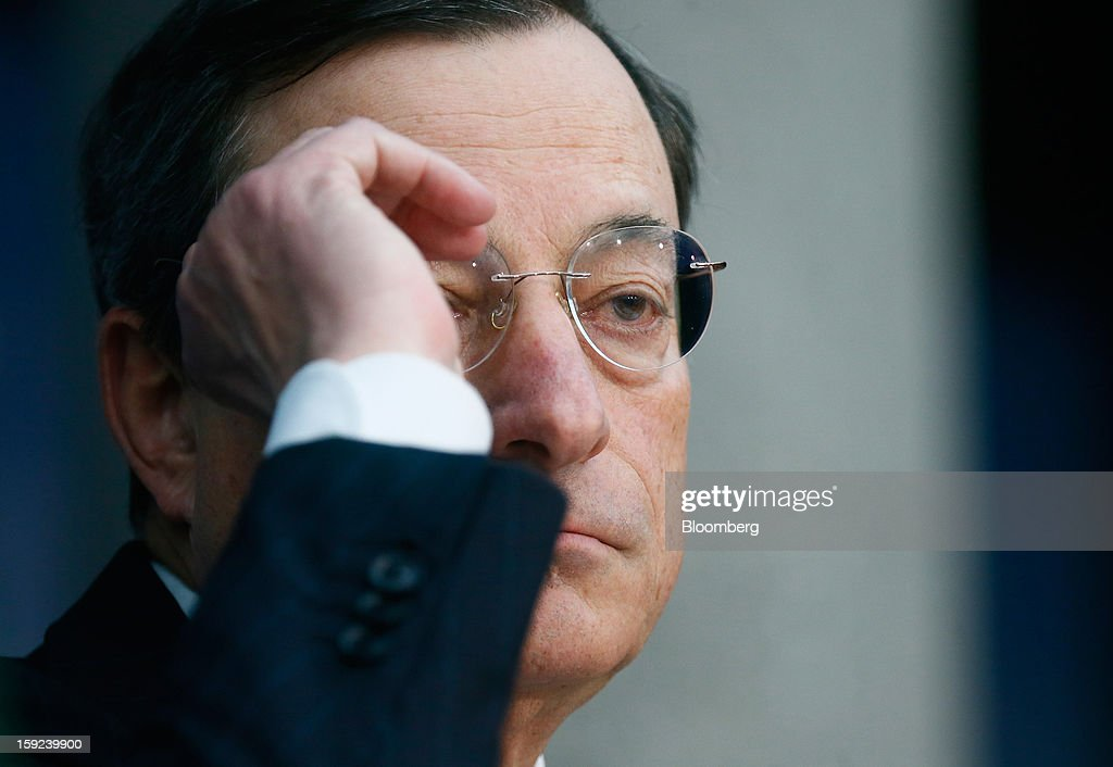 Mario Draghi, president of the European Central Bank (ECB), adjusts his spectacles during a news conference at the bank's headquarters in Frankfurt, Germany, on Thursday, Jan. 10, 2013. Draghi said the euro-area economy will slowly recover this year as the region's bond markets stabilize after three years of turmoil. Photographer: Ralph Orlowski/Bloomberg via Getty Images