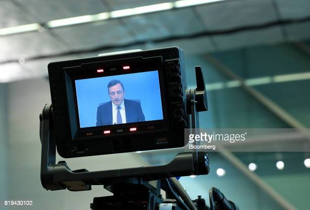 Mario Draghi president of the European Central Bank appears on a television camera viewfinder monitor during a news conference following the bank's...