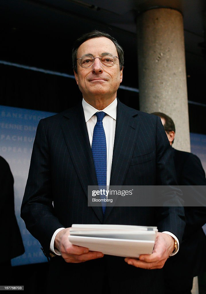 Mario Draghi, president of the European Central Bank (ECB), arrives for a news conference at the bank's headquarters in Frankfurt, Germany, on Thursday, Dec. 6, 2012. The European Central Bank cut its economic and inflation forecasts and Draghi said weakness will persist into next year, leaving the door ajar for further interest-rate cuts. Photographer: Ralph Orlowski/Bloomberg via Getty Images