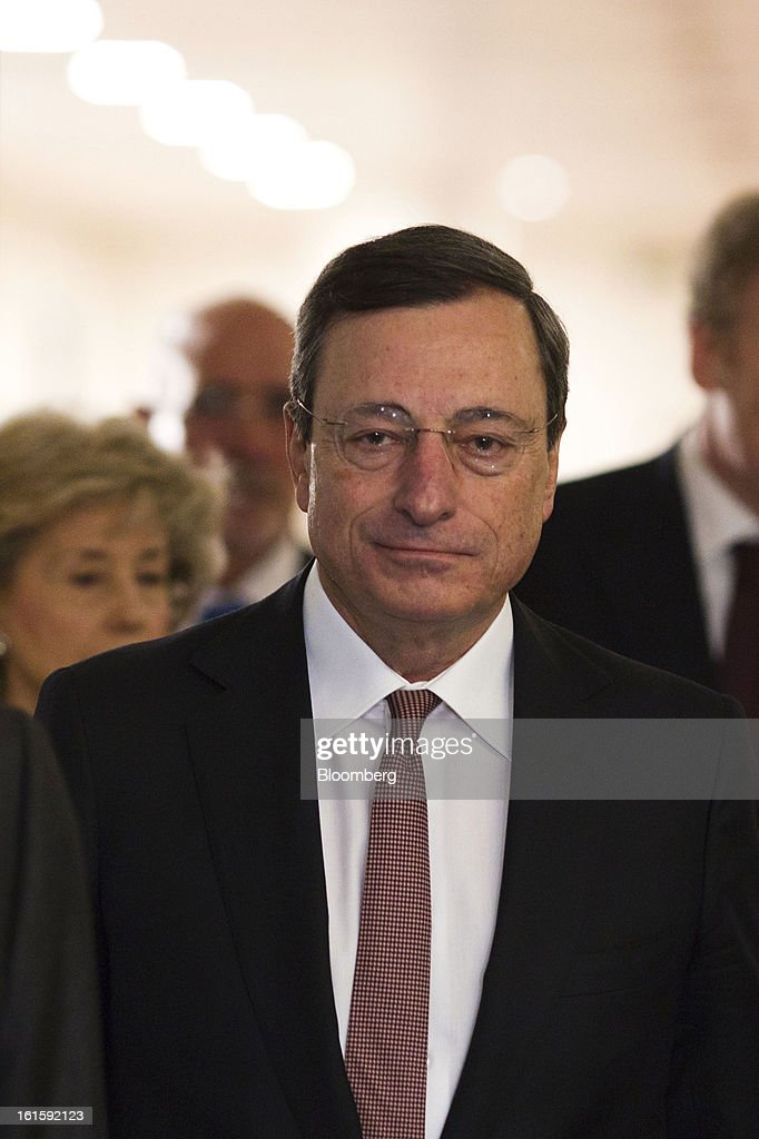 Mario Draghi, president of the European Central Bank (ECB), arrives for a news conference at the Spanish Congress in Madrid, Spain, on Tuesday, Feb. 12, 2013. Draghi said politicians should refrain from calling for intervention on the euro's exchange rate. Photographer: Angel Navarrete/Bloomberg via Getty Images