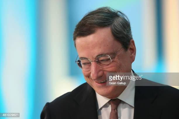 Mario Draghi President of the European Central Bank arrives to speak at the Sueddeutsche Zeitung leadership conference on November 21 2013 in Berlin...