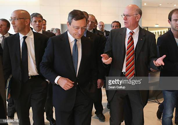 Mario Draghi President of the European Central Bank arrives with Bundestag President Norbert Lammert and ECB Board member Joerg Asmussen to speak to...
