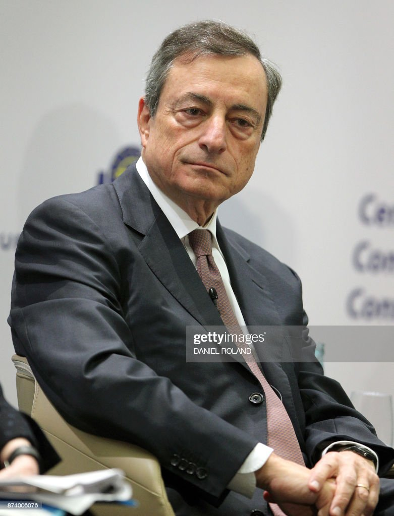 Mario Draghi, President of the European Central Bank (ECB), attends an ECB conference titled 'Communications Challenges for Policy Effectiveness' at the ECB headquarters in Frankfurt am Main, western Germany, on November 14, 2017. / AFP PHOTO / Daniel ROLAND