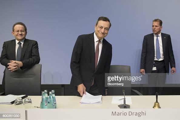 Mario Draghi president of the European Central Bank center and Vitor Constancio vice president of the European Central Bank left arrive for a news...
