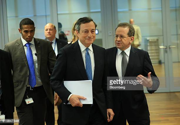 Mario Draghi president of the European Central Bank center and Vitor Constancio vice president of the European Central Bank right arrive for a news...