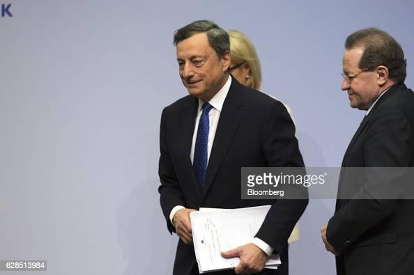 Mario Draghi president of the European Central Bank center and Vitor Constancio vice president of the European Central Bank right depart following a...