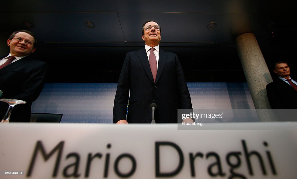 Mario Draghi, president of the European Central Bank (ECB), center, arrives for the news conference at the bank's headquarters in Frankfurt, Germany, on Thursday, Jan. 10, 2013. Draghi said the euro-area economy will slowly recover this year as the region's bond markets stabilize after three years of turmoil. Photographer: Ralph Orlowski/Bloomberg via Getty Images