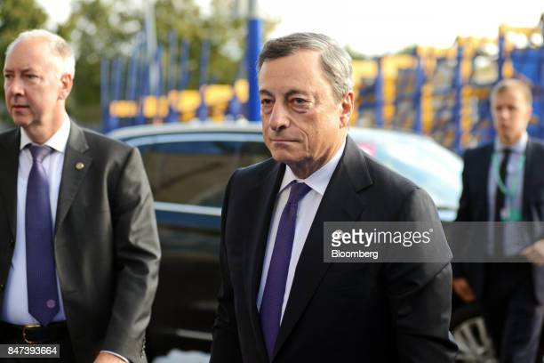Mario Draghi president of the European Central Bank center arrives for the Eurogroup meeting in Tallinn Estonia on Friday Sept 15 2017 The monetary...