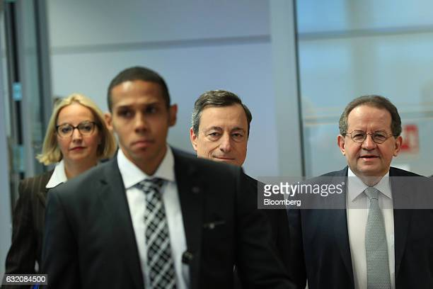 Mario Draghi president of the European Central Bank center Christine Graeff director general for communications at the European Central Bank left and...