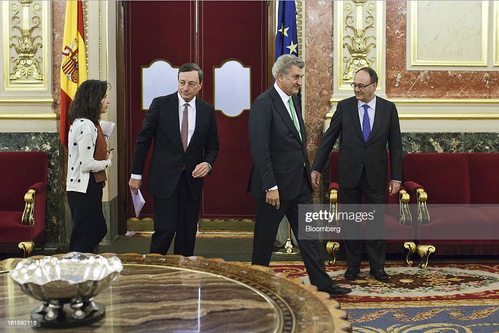 Mario Draghi, president of the European Central Bank (ECB), center left, arrives for a news conference with Luis Maria Linde, governor of the Bank of Spain, right, and Jesus Posada, president of the Congress of Deputies, center right, at the Spanish Congress in Madrid, Spain, on Tuesday, Feb. 12, 2013. Draghi said politicians should refrain from calling for intervention on the euro's exchange rate. Photographer: Angel Navarrete/Bloomberg via Getty Images