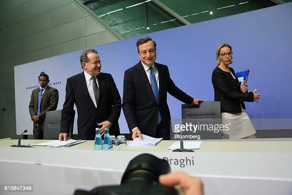 Mario Draghi president of the European Central Bank center pauses Vitor Constancio vice president of the European Central Bank second left and...
