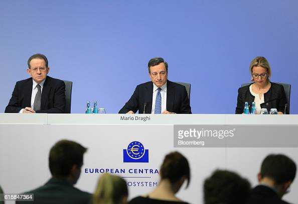 Mario Draghi president of the European Central Bank center pauses Vitor Constancio vice president of the European Central Bank left and Christine...