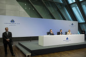 Mario Draghi president of the European Central Bank center speaks as he sits between Vitor Constancio vice president of the European Central Bank...