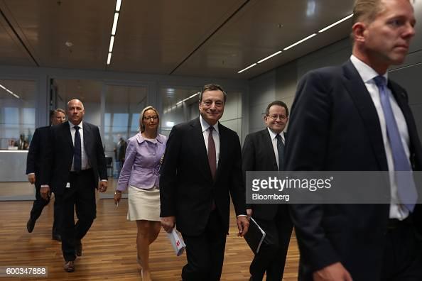 Mario Draghi president of the European Central Bank center Vitor Constancio vice president of the European Central Bank second right and Christine...