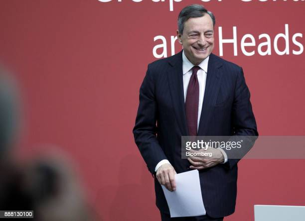 Mario Draghi president of the European Central Bank departs a Basel III capital rules news conference at the ECB headquarters in Frankfurt Germany on...