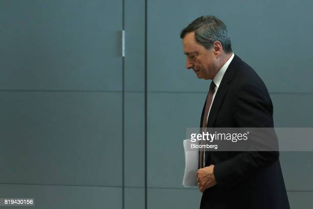 Mario Draghi president of the European Central Bank departs a news conference following the bank's interest rate decision at the ECB headquarters in...