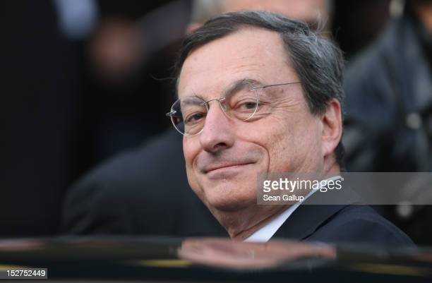 Mario Draghi president of the European Central Bank departs after speaking at a conference of the German Federation of Industry on September 25 2012...
