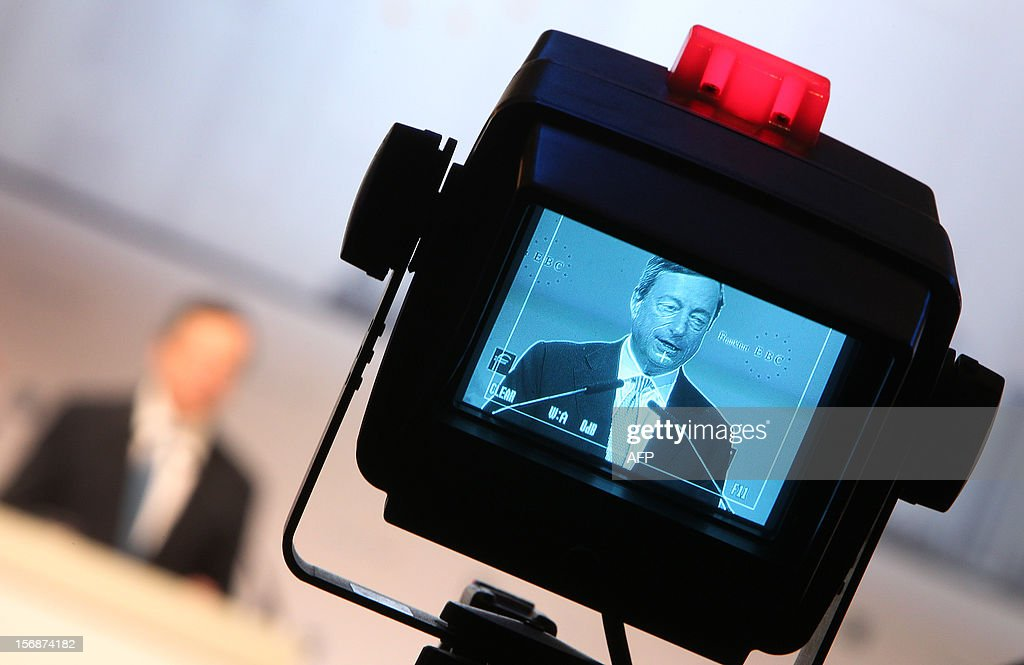 Mario Draghi, President of the European Central Bank ECB, is seen in the camera screen as he delivers a speech at the European Banking Congress EBC in Frankfurt, central Germany, on November 23, 2012. Business confidence in Germany made a surprise return in November, data suggested on Friday, after falling for six months amid the eurozone's debt crisis.