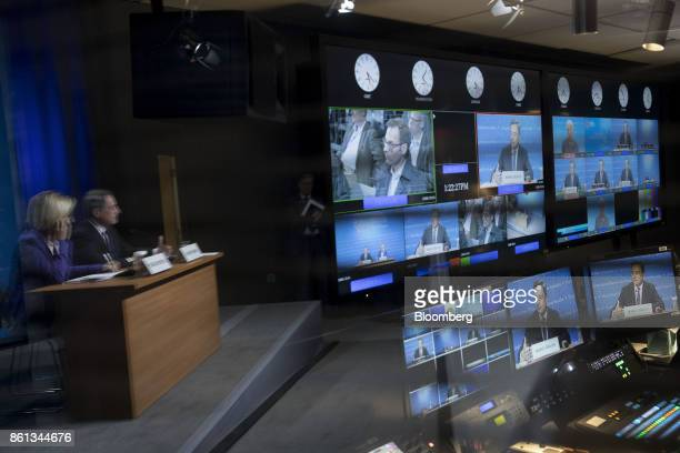 Mario Draghi president of the European Central Bank is displayed on monitors in a television control room while speaking during a news conference at...