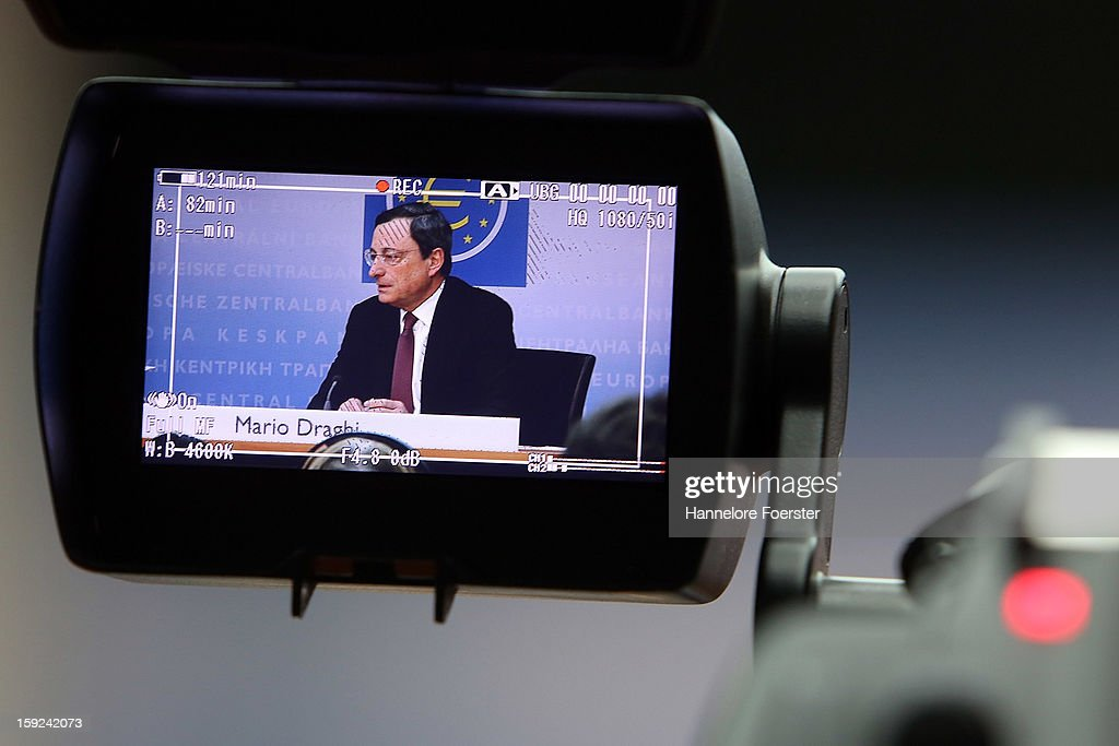 Mario Draghi, President of the European Central Bank (ECB), is viewed through a camera as he speaks to the media following a meeting of ECB leadership at the European Central Bank on January 10, 2013 in Frankfurt, Germany. The ECB is facing strong challenges in 2013, as it forecasts the Eurozone economy to shrink by 0.3% and analysts remain sceptical whether the bank can reign in and centralise supervision of the Eurozone's biggest banks.