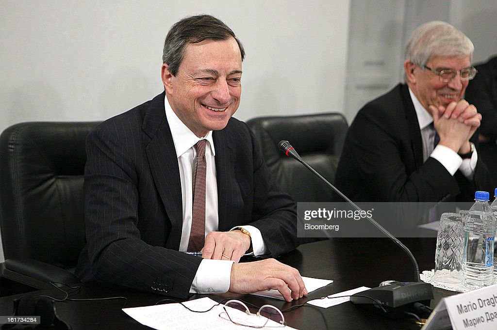 <a gi-track='captionPersonalityLinkClicked' href=/galleries/search?phrase=Mario+Draghi&family=editorial&specificpeople=571678 ng-click='$event.stopPropagation()'>Mario Draghi</a>, president of the European Central Bank (ECB), left, and Sergey Ignatiev, chairman of Bank Rossii, Russia's central bank, react during a news conference in Moscow, Russia, on Friday, Feb. 15, 2013. Draghi said while the ECB doesn't target the exchange rate, it plays an important role in assessing the economic outlook. Photographer: Alexander Zemlianichenko Jr./Bloomberg via Getty Images