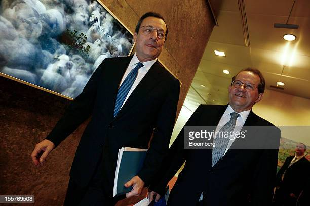 Mario Draghi president of the European Central Bank left and Vitor Constancio vice president of the European Central Bank arrive to attend a news...