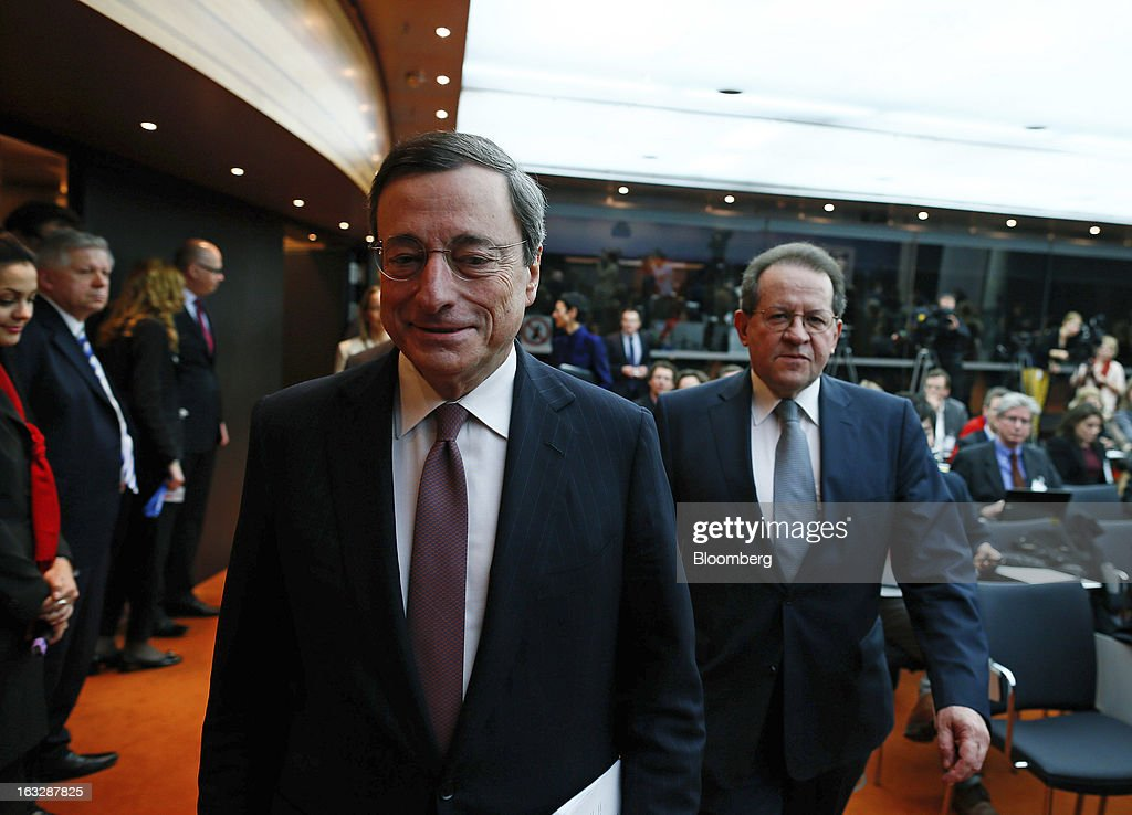 Mario Draghi, president of the European Central Bank (ECB), left, and Vitor Constancio, vice president of the European Central Bank, arrive to attend a news conference at the bank's headquarters in Frankfurt, Germany, on Thursday, March 7, 2013. Draghi stuck to his view that the euro-area economy will gradually recover later this year as policy makers trimmed their economic and inflation forecasts. Photographer: Ralph Orlowski/Bloomberg via Getty Images