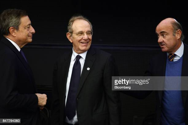 Mario Draghi president of the European Central Bank left Pier Carlo Padoan Italy's finance minister center and Luis de Guindos Spain's economy...