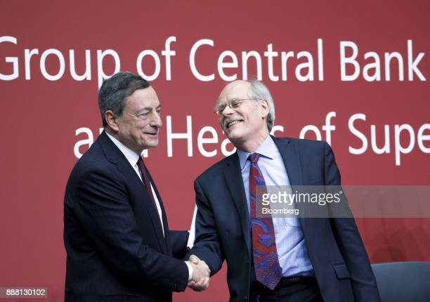 Mario Draghi president of the European Central Bank left shakes hands with Stefan Ingves governor of the Sveriges Riksbank and chairman of the Basel...