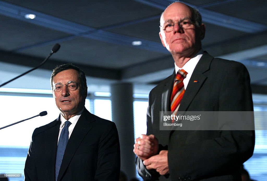 <a gi-track='captionPersonalityLinkClicked' href=/galleries/search?phrase=Mario+Draghi&family=editorial&specificpeople=571678 ng-click='$event.stopPropagation()'>Mario Draghi</a>, president of the European Central Bank (ECB), left, speaks as Norbert Lammert, president of the Bundestag, right, listens during a news conference after speaking to lawmakers in the lower-house of the German Parliament in Berlin, Germany, on Wednesday, Oct. 24, 2012. Draghi defended his plan to buy government bonds in the German parliament today with a warning about deflation risks. Photographer: Michele Tantussi/Bloomberg via Getty Images