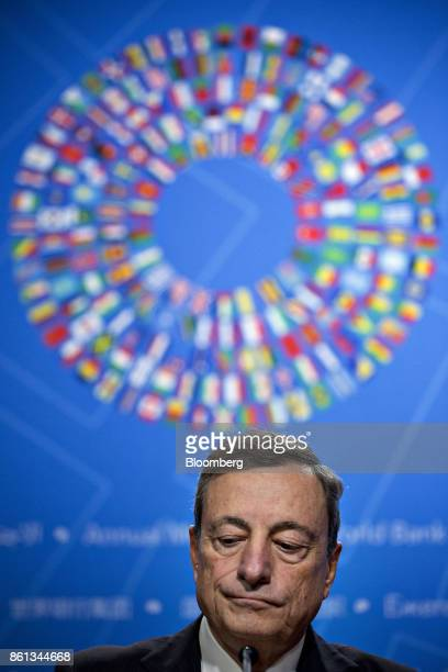 Mario Draghi president of the European Central Bank listens to a question during a news conference at the International Monetary Fund and World Bank...