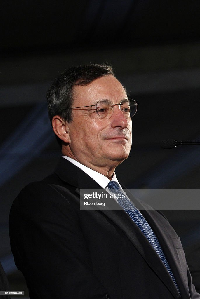 <a gi-track='captionPersonalityLinkClicked' href=/galleries/search?phrase=Mario+Draghi&family=editorial&specificpeople=571678 ng-click='$event.stopPropagation()'>Mario Draghi</a>, president of the European Central Bank (ECB), pauses during a news conference after speaking to lawmakers in the lower-house of the German Parliament in Berlin, Germany, on Wednesday, Oct. 24, 2012. Draghi defended his plan to buy government bonds in the German parliament today with a warning about deflation risks. Photographer: Michele Tantussi/Bloomberg via Getty Images