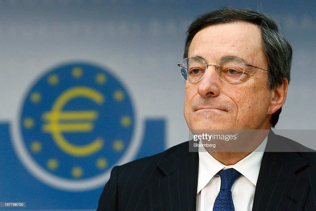 Mario Draghi, president of the European Central Bank (ECB), pauses during a news conference at the bank's headquarters in Frankfurt, Germany, on Thursday, Dec. 6, 2012. The European Central Bank cut its economic and inflation forecasts and Draghi said weakness will persist into next year, leaving the door ajar for further interest-rate cuts. Photographer: Ralph Orlowski/Bloomberg via Getty Images