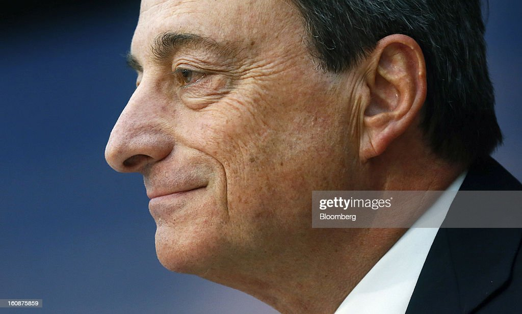 <a gi-track='captionPersonalityLinkClicked' href=/galleries/search?phrase=Mario+Draghi&family=editorial&specificpeople=571678 ng-click='$event.stopPropagation()'>Mario Draghi</a>, president of the European Central Bank (ECB), pauses during a news conference at the bank's headquarters in Frankfurt, Germany, on Thursday, Feb.7, 2013. The European Central Bank left interest rates unchanged even as a stronger currency threatens the euro area's recovery from recession. Photographer: Ralph Orlowski/Bloomberg via Getty Images