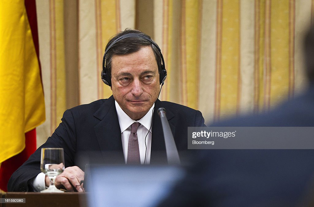 Mario Draghi, president of the European Central Bank (ECB), pauses during a news conference at the Spanish Congress in Madrid, Spain, on Tuesday, Feb. 12, 2013. Draghi said politicians should refrain from calling for intervention on the euro's exchange rate. Photographer: Angel Navarrete/Bloomberg via Getty Images