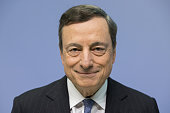 Mario Draghi president of the European Central Bank poses for a photograph as he arrives for a news conference to announce the bank's interest rate...