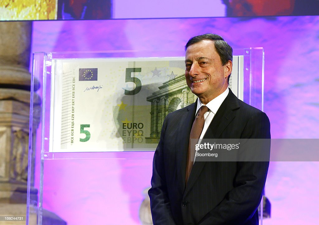 Mario Draghi, president of the European Central Bank (ECB), poses for a photograph alongside the new design for the 5 euro bank note, the first denomination of the Europa series during an event at the Archaeological Museum in Frankfurt, Germany, on Thursday, Jan. 10, 2013. Draghi today unveiled a new 5-euro banknote to be introduced on May 2 as the first of the new 'Europa series' with new security features. Photographer: Ralph Orlowski/Bloomberg via Getty Images