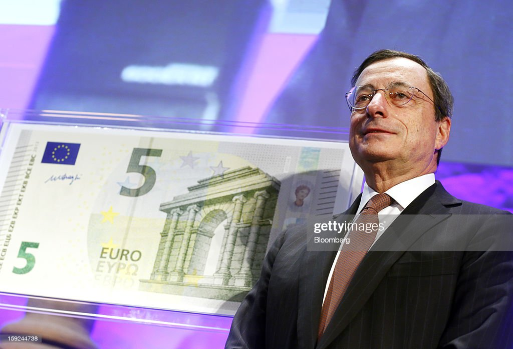 Mario Draghi, president of the European Central Bank (ECB), poses for a photograph alongside the new design for the 5 euro bank note, the first denomination of the Europa series, during an event at the Archaeological Museum in Frankfurt, Germany, on Thursday, Jan. 10, 2013. Draghi today unveiled a new 5-euro banknote to be introduced on May 2 as the first of the new 'Europa series' with new security features. Photographer: Ralph Orlowski/Bloomberg via Getty Images