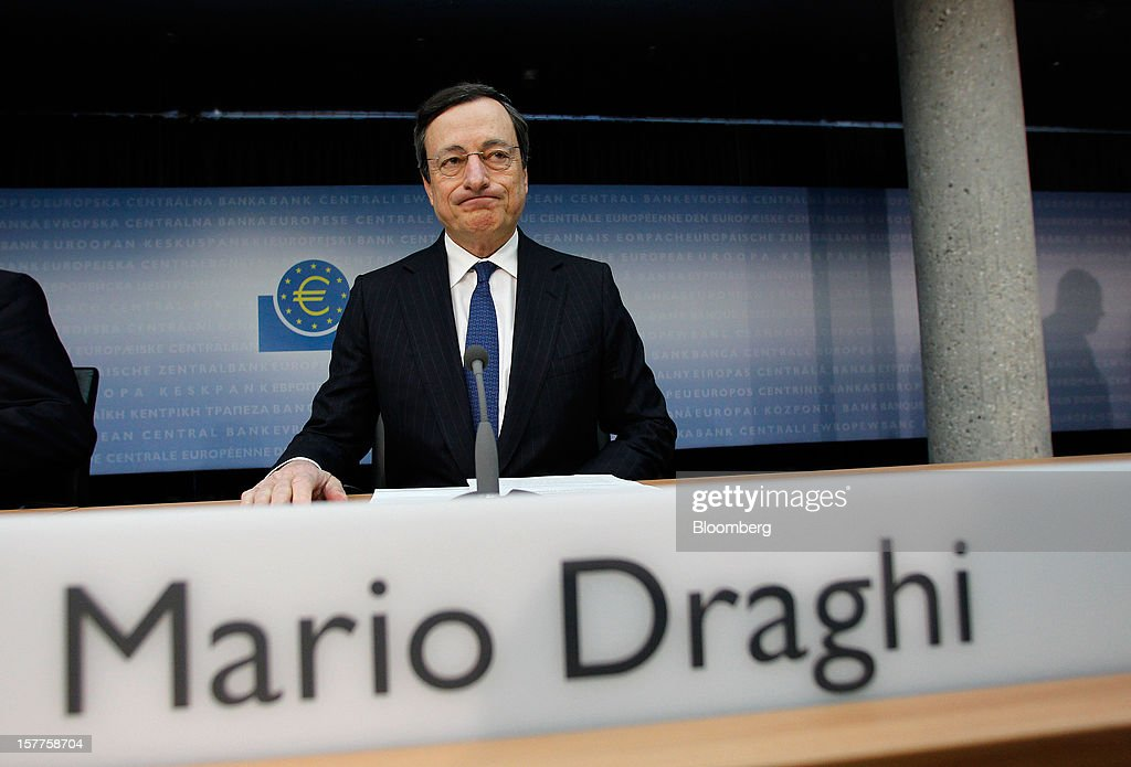 Mario Draghi, president of the European Central Bank (ECB), reacts during a news conference at the bank's headquarters in Frankfurt, Germany, on Thursday, Dec. 6, 2012. The European Central Bank cut its economic and inflation forecasts and Draghi said weakness will persist into next year, leaving the door ajar for further interest-rate cuts. Photographer: Ralph Orlowski/Bloomberg via Getty Images