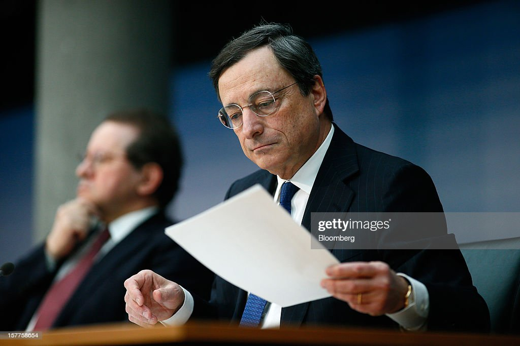 Mario Draghi, president of the European Central Bank (ECB), reads his notes during a news conference at the bank's headquarters in Frankfurt, Germany, on Thursday, Dec. 6, 2012. The European Central Bank cut its economic and inflation forecasts and Draghi said weakness will persist into next year, leaving the door ajar for further interest-rate cuts. Photographer: Ralph Orlowski/Bloomberg via Getty Images