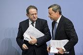 Mario Draghi president of the European Central Bank right and Vitor Constancio vice president of the European Central Bank depart following a news...
