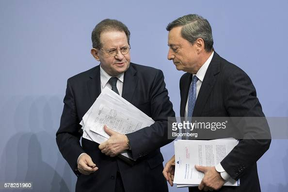 Mario Draghi president of the European Central Bank right and Vitor Constancio vice president of the European Central Bank depart following a news...