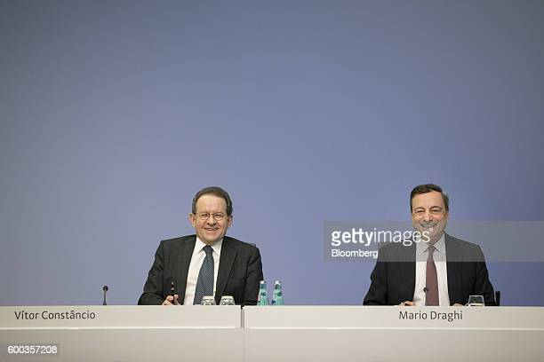 Mario Draghi president of the European Central Bank right and Vitor Constancio vice president of the European Central Bank react during a news...