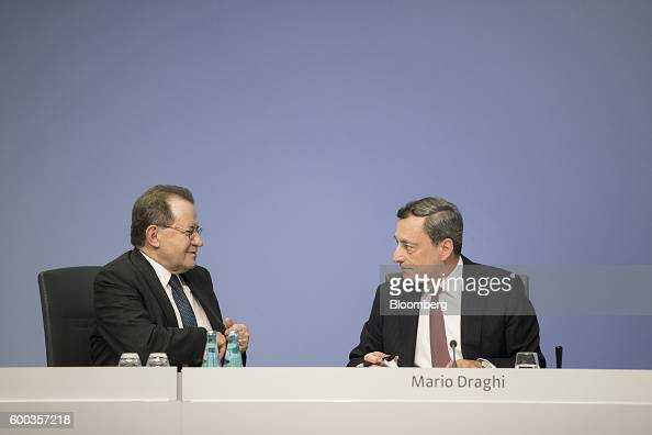 Mario Draghi president of the European Central Bank right and Vitor Constancio vice president of the European Central Bank speak at the end of a news...
